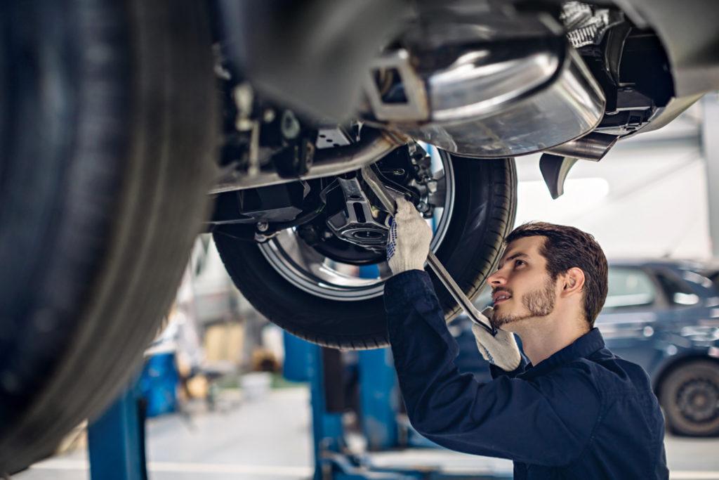 Mechanic Examining Suspension